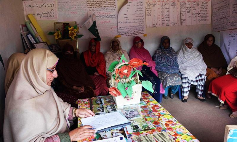 Women discuss issues with NGO head Nusrat Yousuf in women's market Rawalakot.jpg